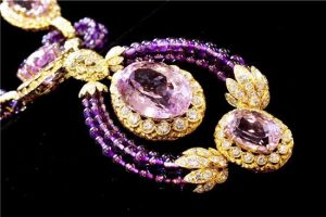 "Part of a Suite of Kunzite, amethyst and diamond ""Triphanes"" jewelry by Van Cleef & Arpels, from Elizabeth Taylor's estate, is shown in this photograph at Christie's, in New York, Thursday, Sept. 1, 2001. It is estimated at $70,000 ? $100,000. Christie's auction house is selling her complete jewelry collection in New York on Dec. 13-14. (AP Photo/Richard Drew)"